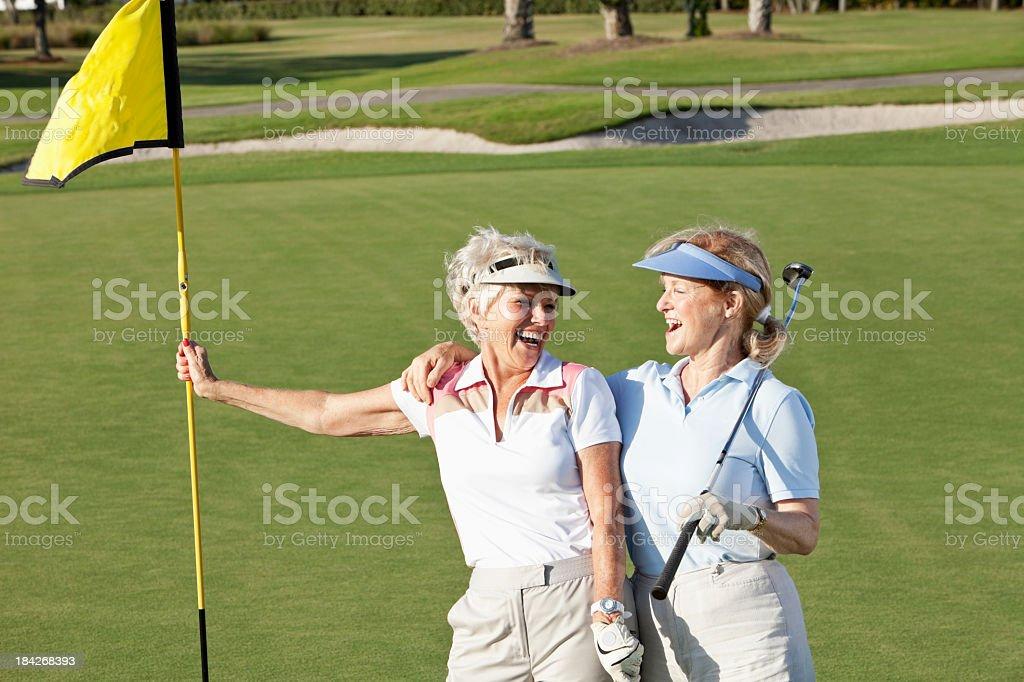 Senior women playing golf. stock photo