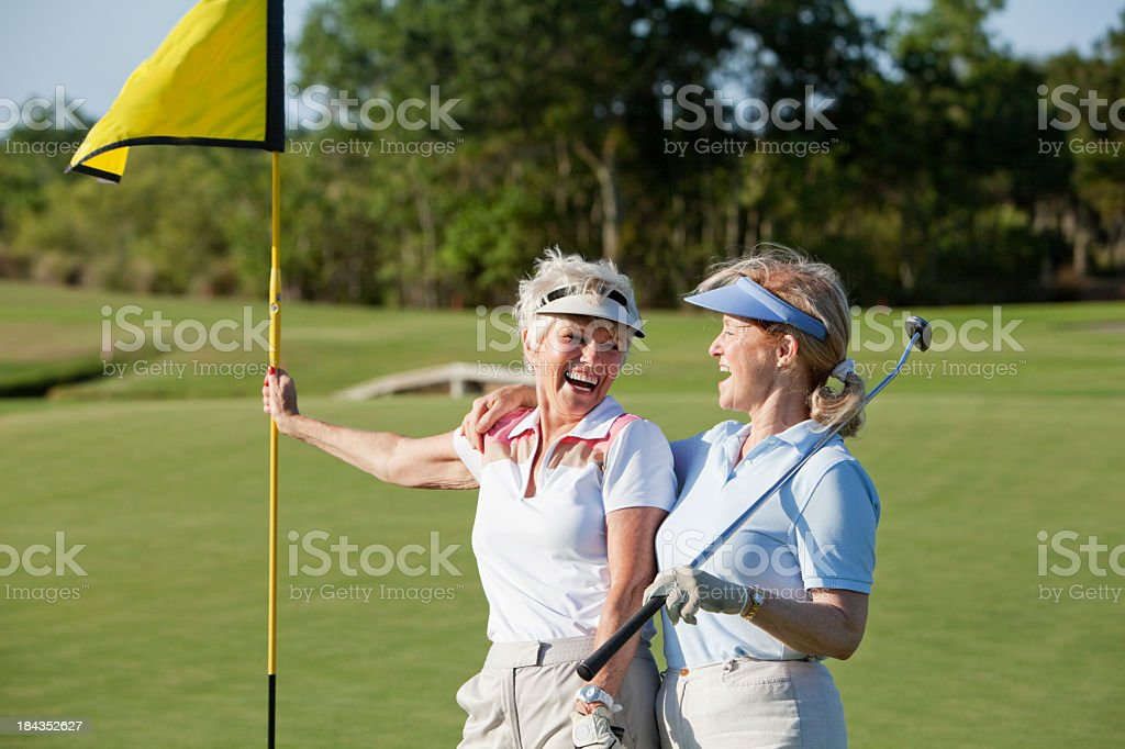 Senior women playing golf. stock photo