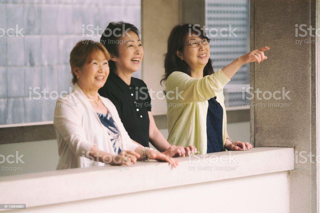 Senior Women Praying in Buddhist Temple stock photo