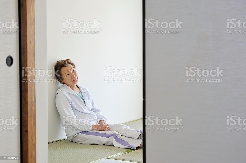 Senior women sit lonely stock photo