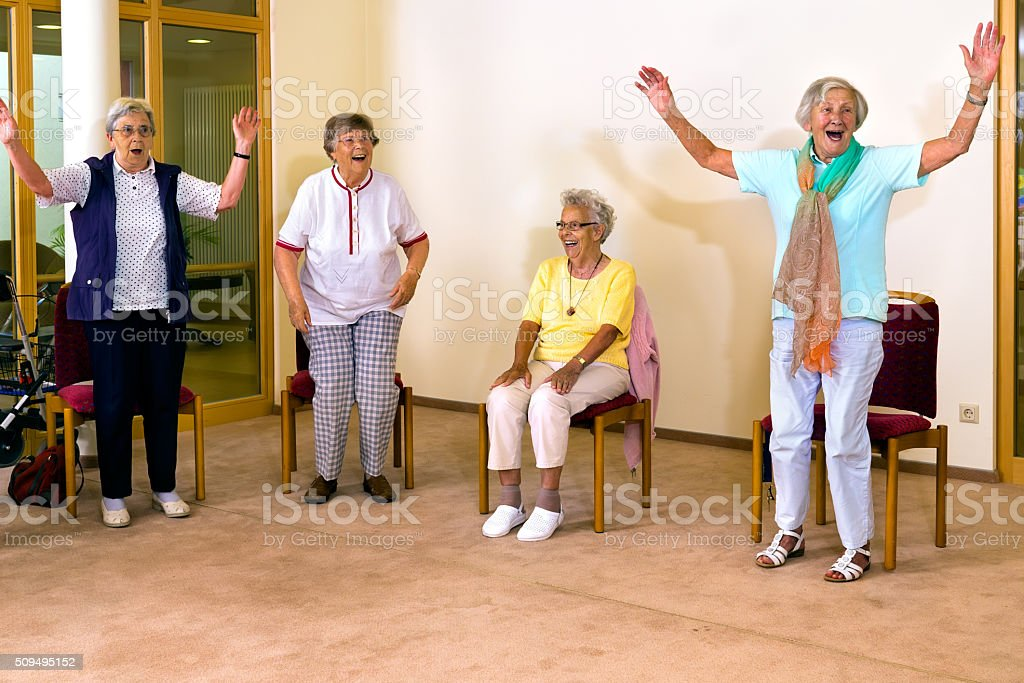 Senior women standing and sitting for exercise. stock photo