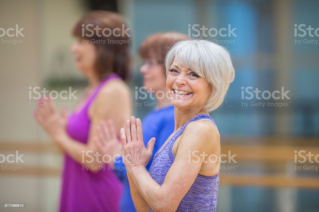 Senior Women Taking a Yoga Class stock photo