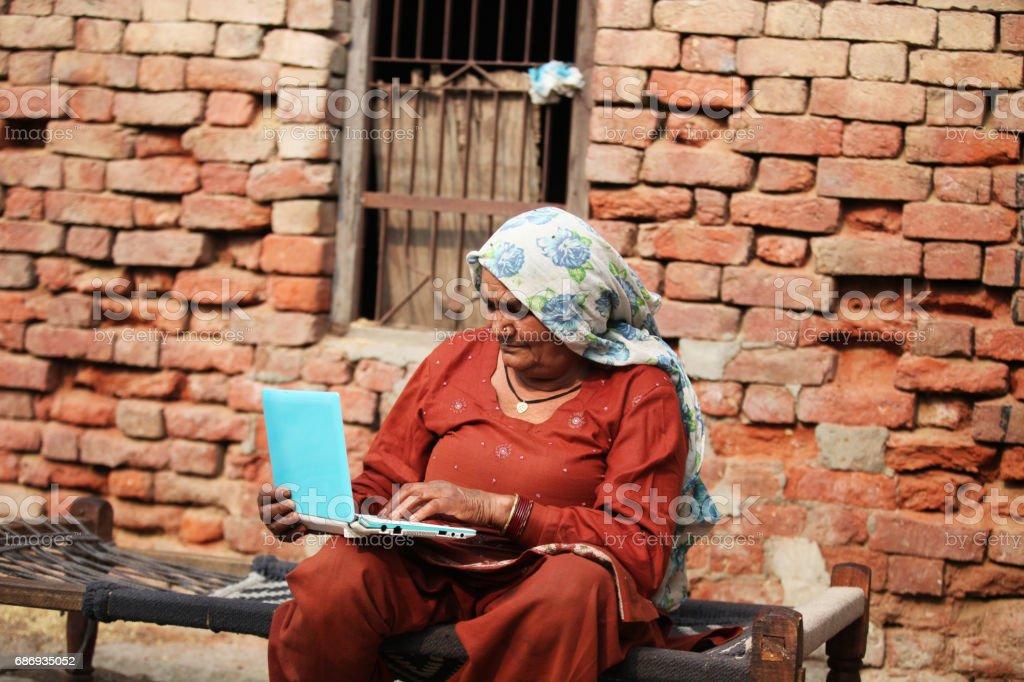 Senior women using laptop stock photo