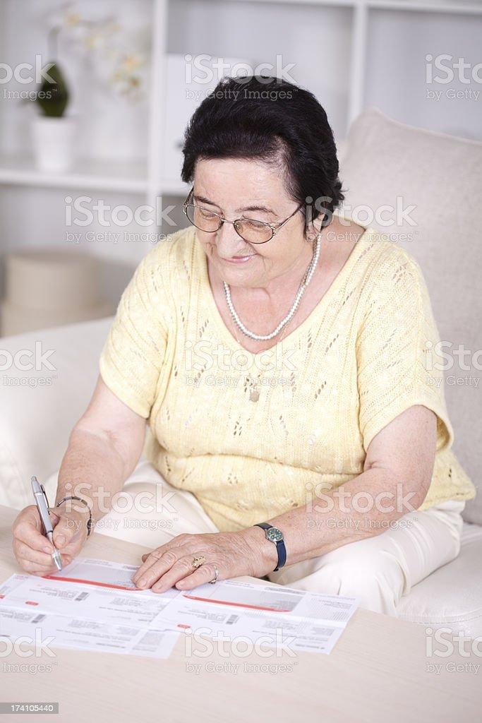 Senior women with bills. royalty-free stock photo