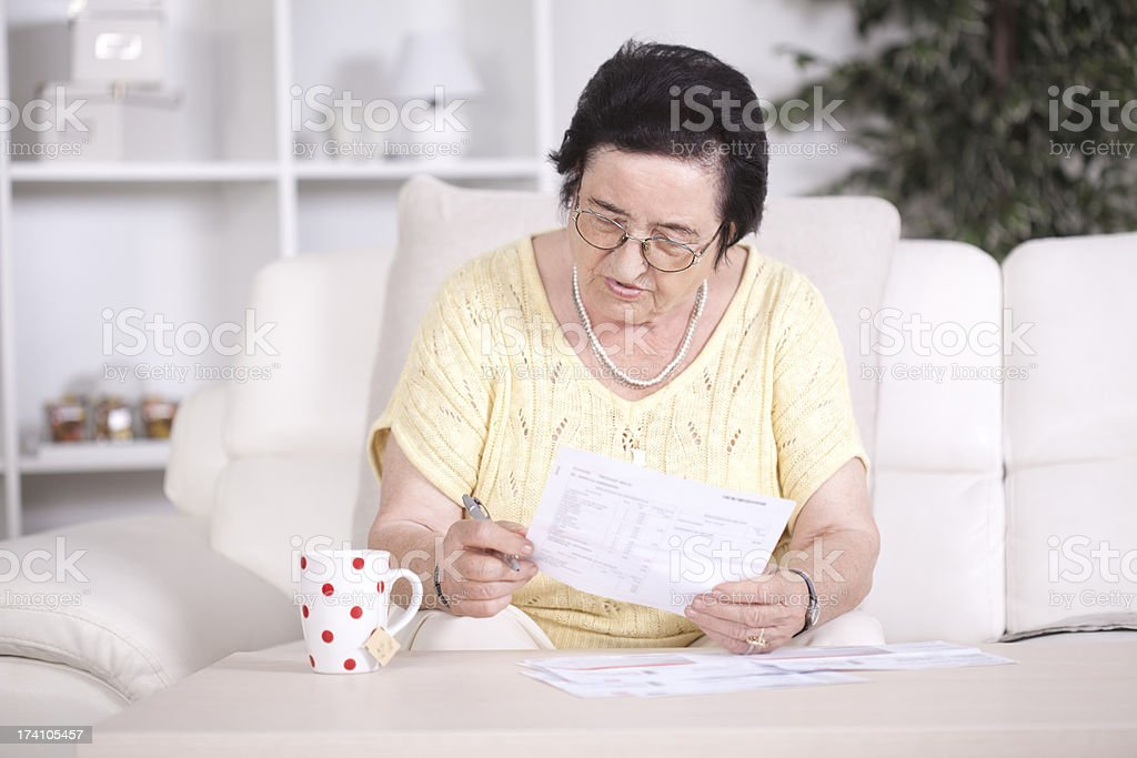 Senior women with bills. stock photo