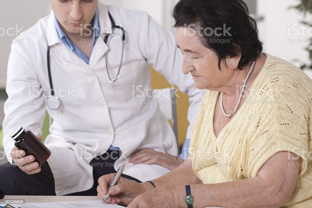 Senior women with doctor. royalty-free stock photo