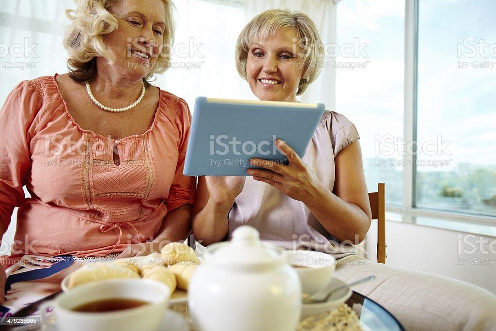 Senior women with tablet royalty-free stock photo