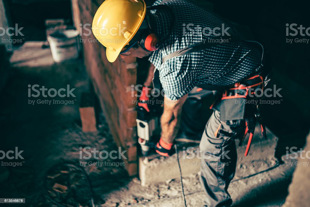 Senior worker with a drill stock photo