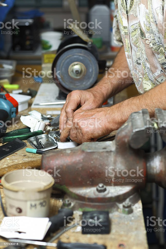 Senior working in workshop royalty-free stock photo