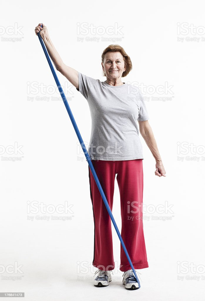 senior working out with a rubberband stock photo