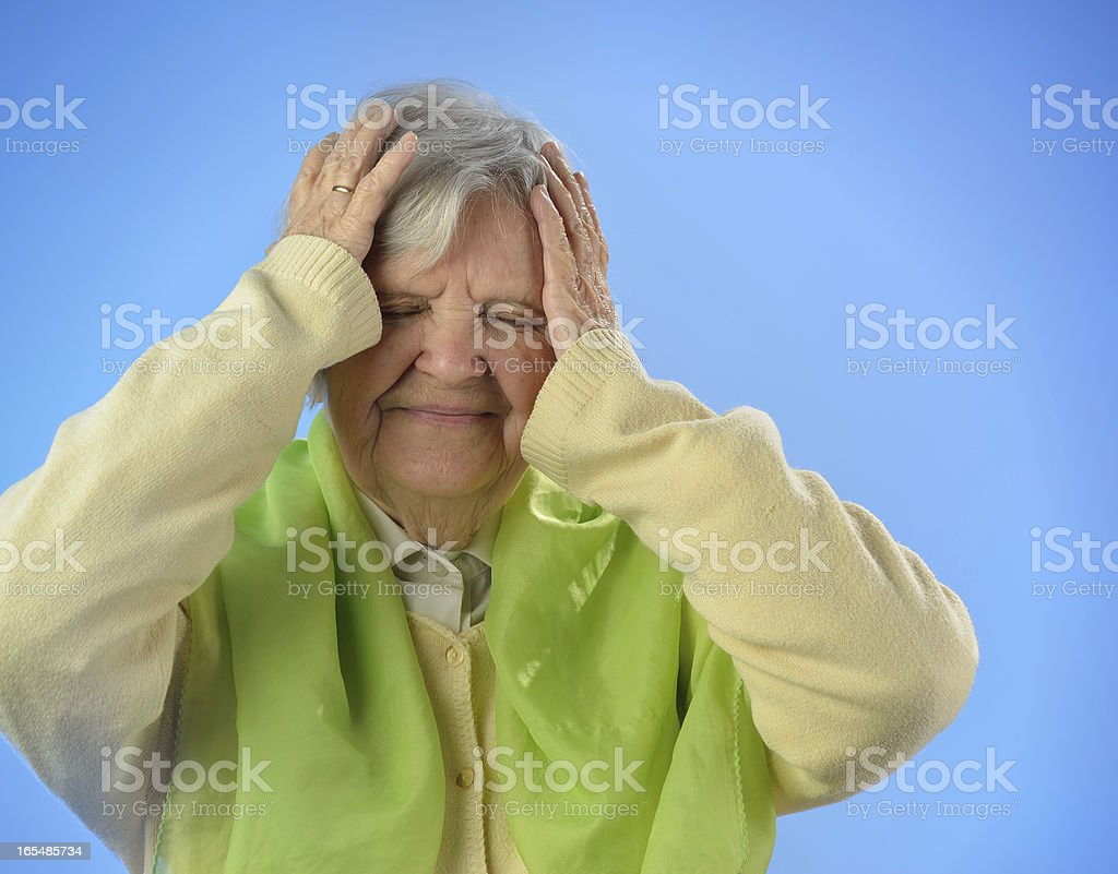 Senior worried woman against blue background. royalty-free stock photo