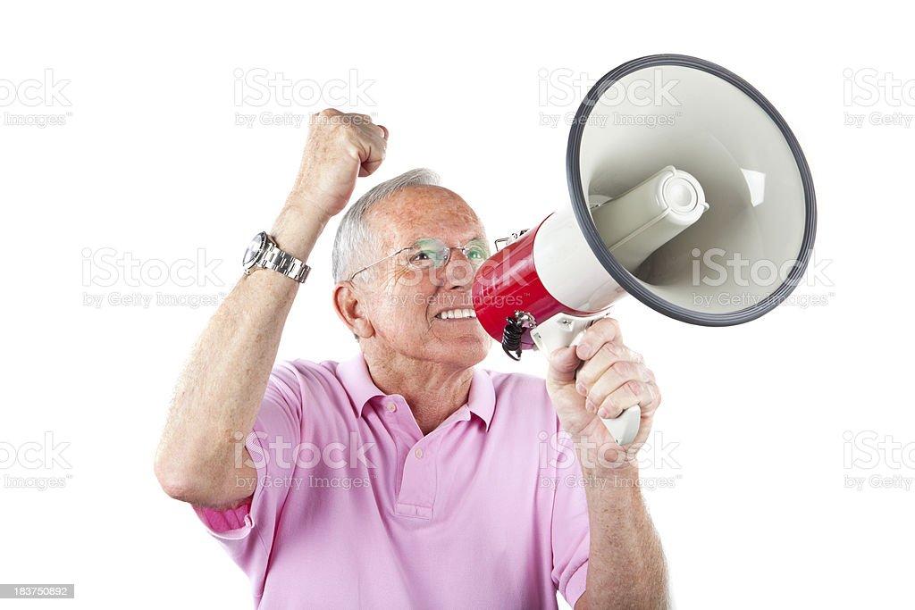 senior yelling in megaphone stock photo