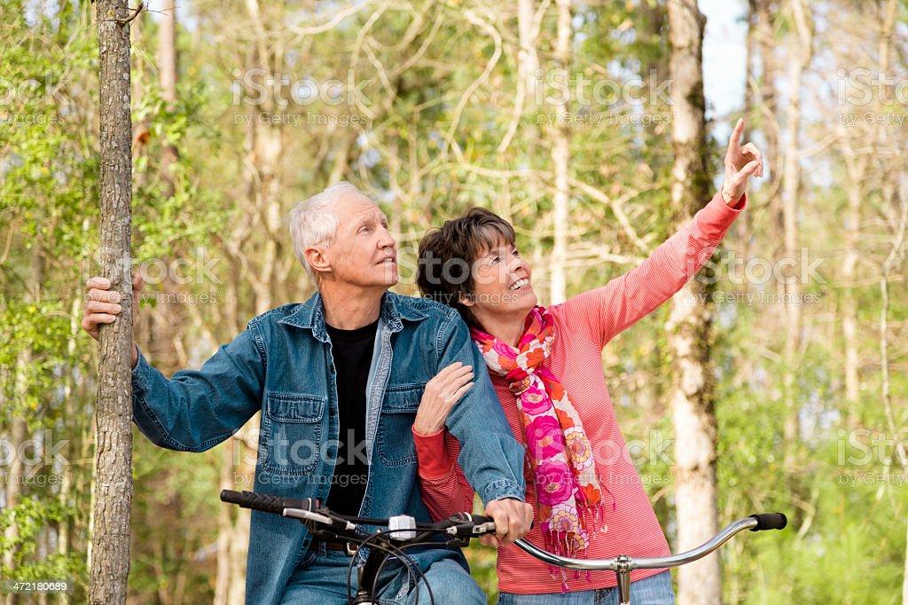 Seniors: Active senior couple outdoors riding bikes. Nature. royalty-free stock photo