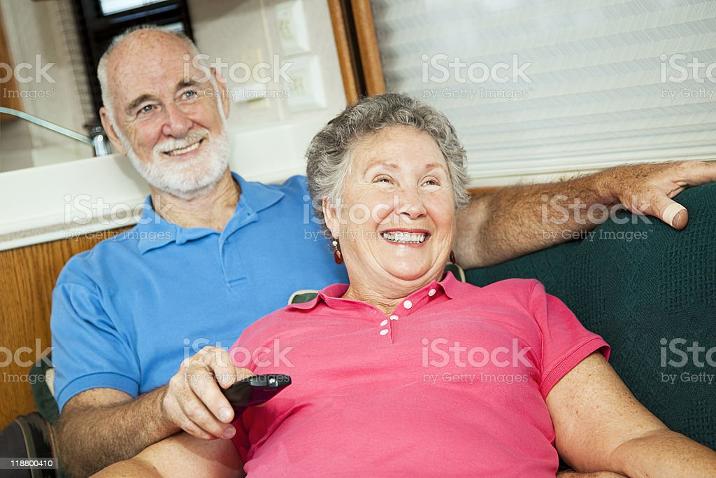 RV Seniors Amused by Television stock photo