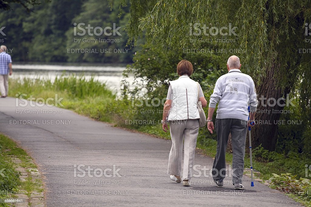 Seniors are having a walk at river Ruhr stock photo