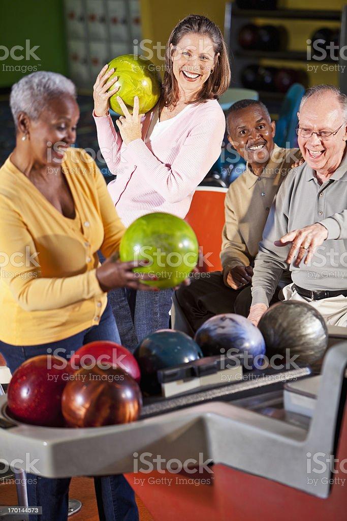 Seniors at bowling alley royalty-free stock photo