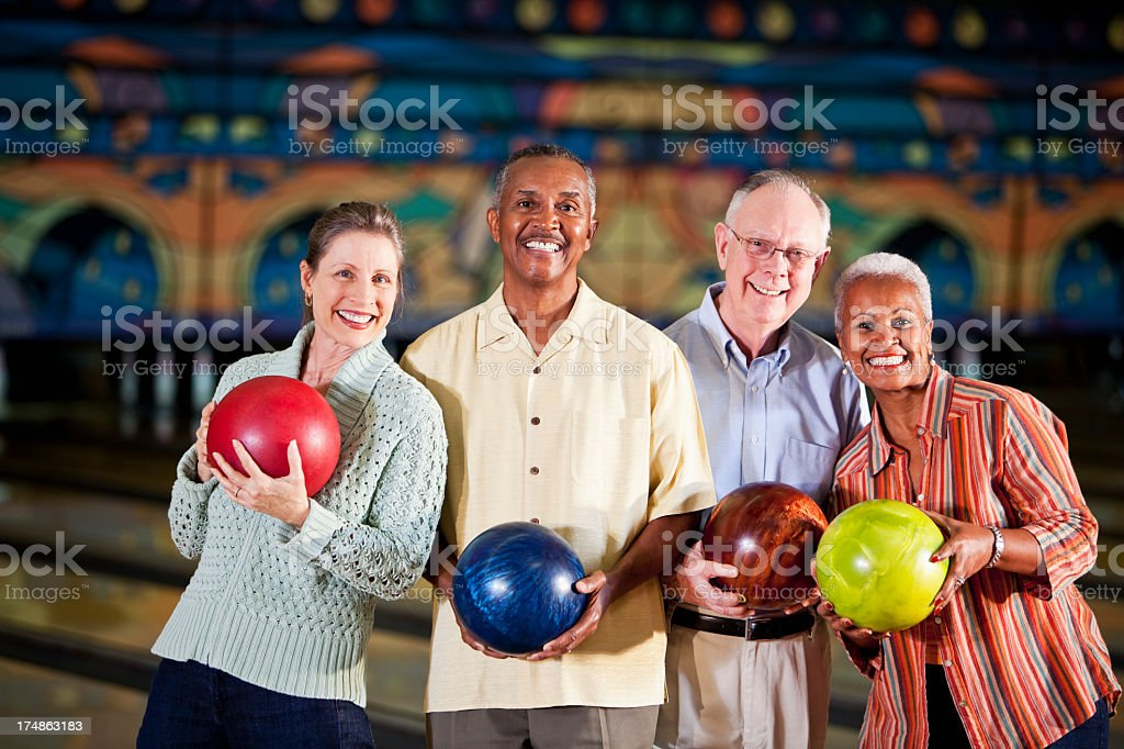 Seniors at bowling alley stock photo