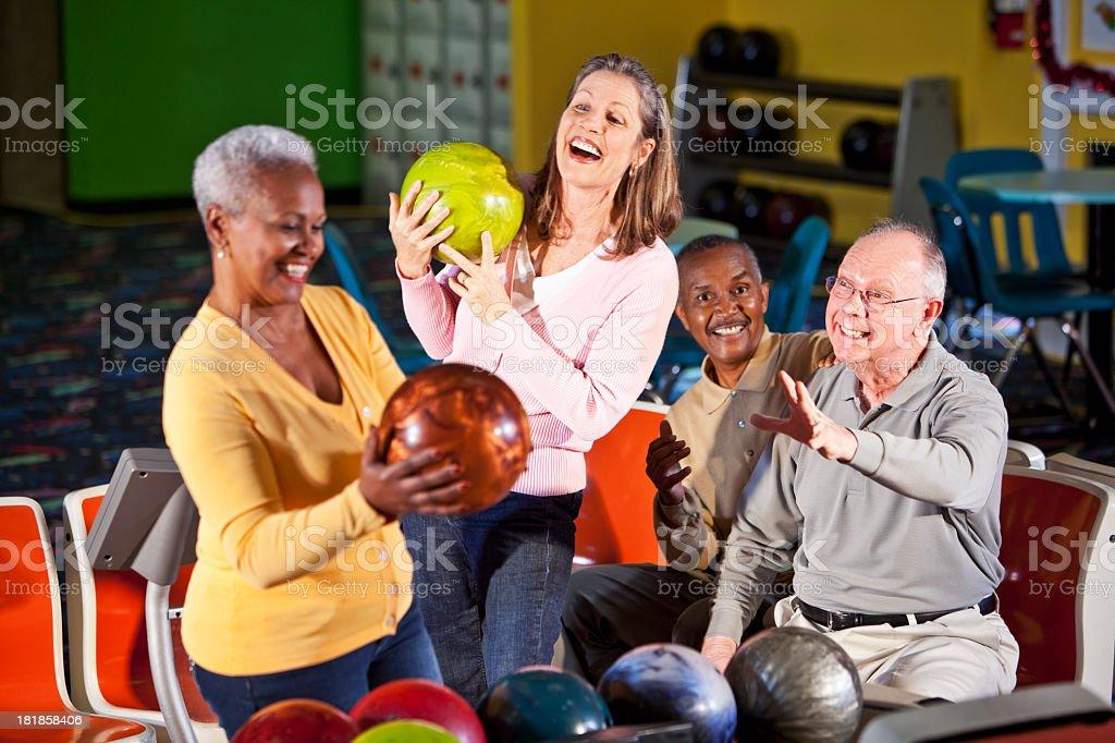 Seniors at bowling alley stock photo
