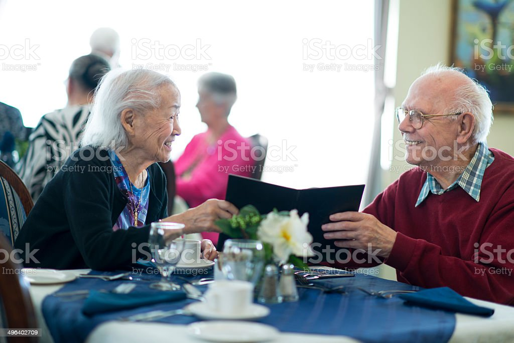 Seniors at restaurant stock photo