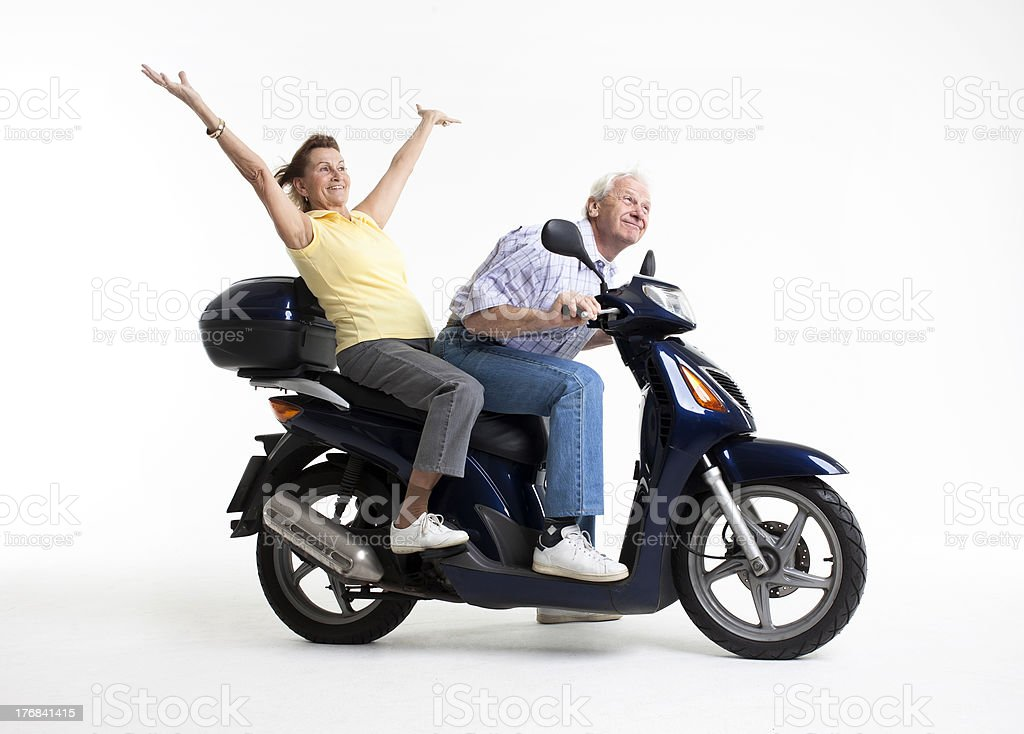 seniors at the motor scooter royalty-free stock photo