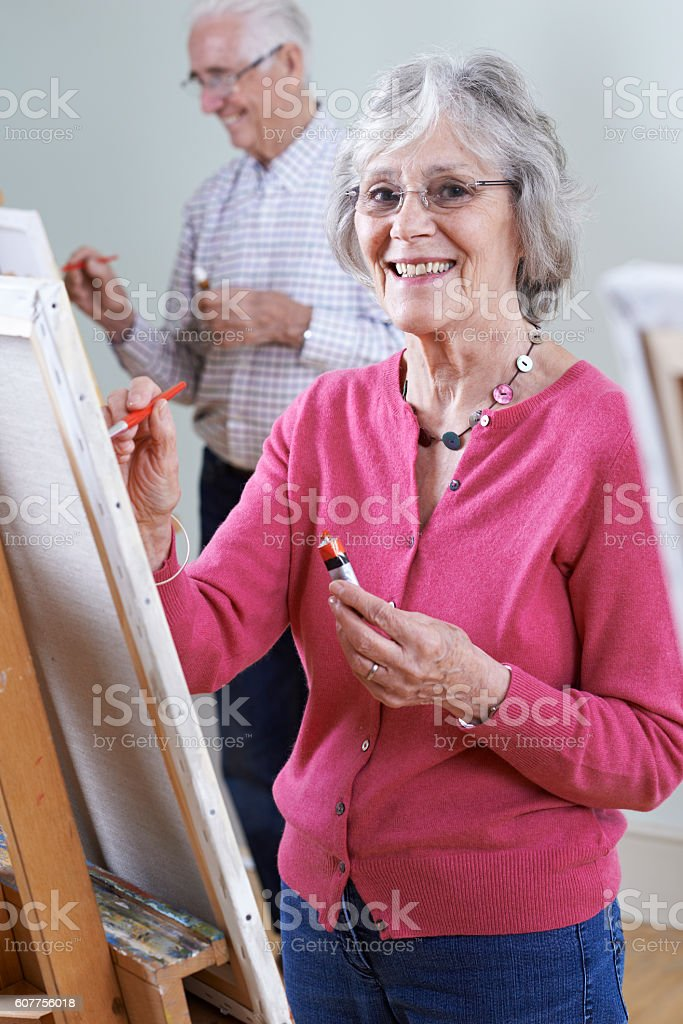 Seniors Attending Painting Class Together stock photo