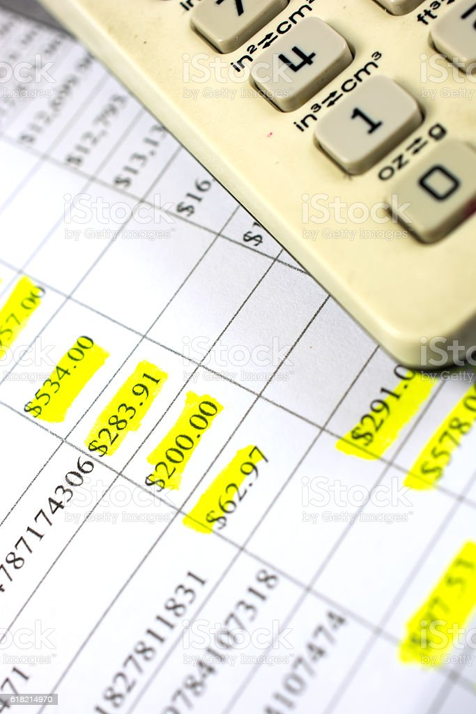 Seniors bank statement with old calcilator upon it stock photo