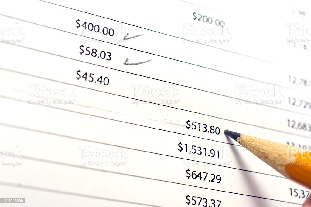 Seniors bank statement with pencil checking the statement stock photo