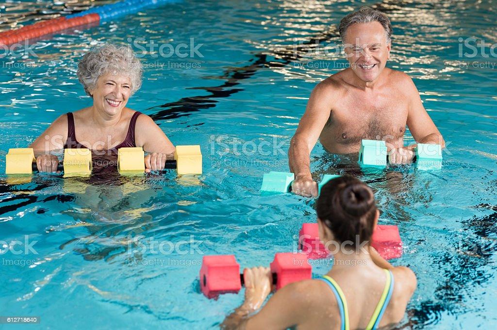 Seniors doing aqua aerobics stock photo