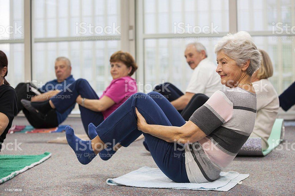 Seniors Doing Stretching Exercises royalty-free stock photo