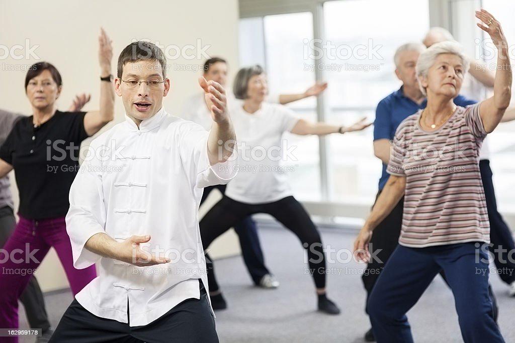 Seniors Doing Tai Chi Exercises stock photo
