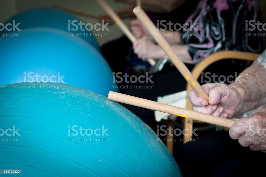 Seniors drumming stock photo