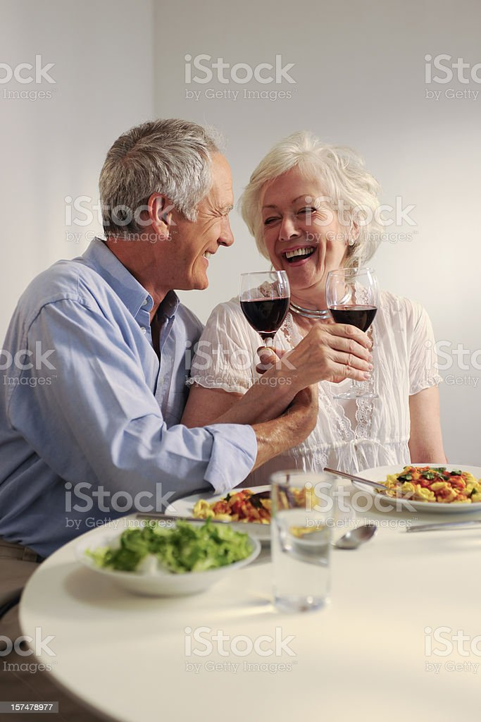 seniors eating evening meal royalty-free stock photo
