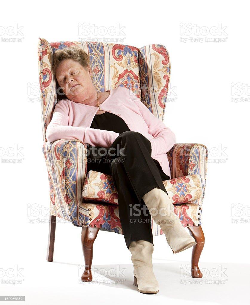 seniors: elderly woman sleeping in comfortable armchair stock photo