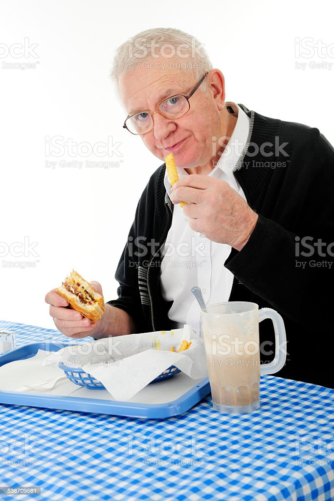 Seniors Enjoy Fast Food Too stock photo