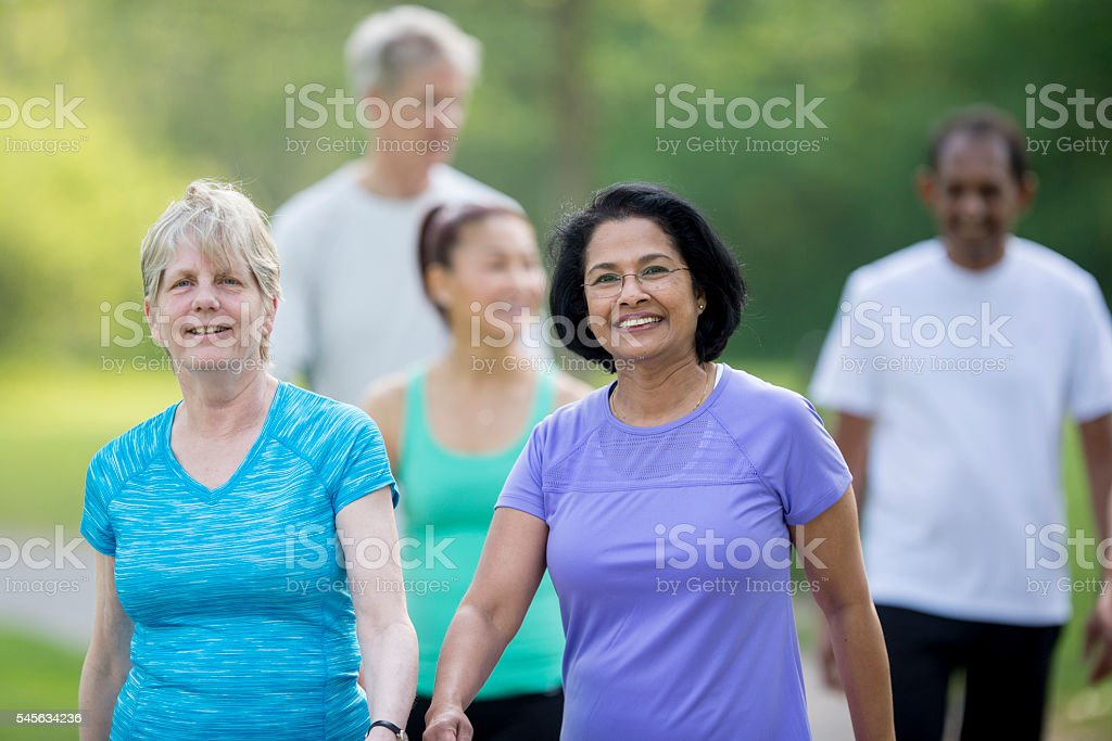 Seniors Enjoying a Walk at the Park stock photo