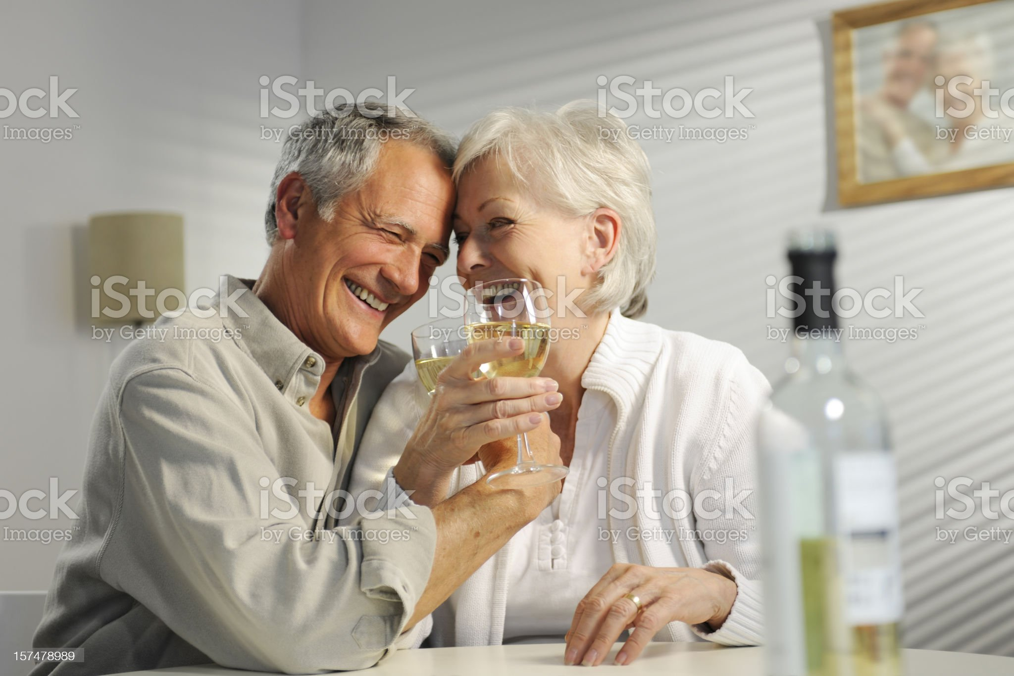 seniors enjoying wine royalty-free stock photo