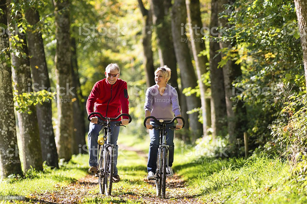 Seniors exercising with bicycle stock photo