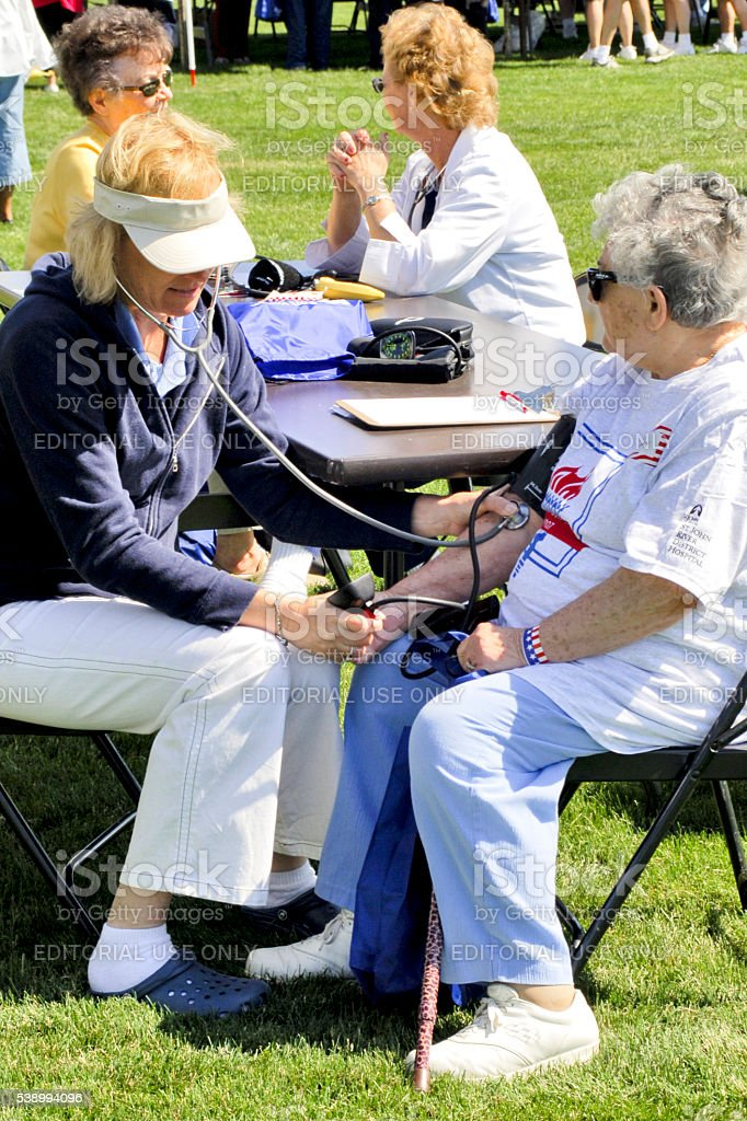 Seniors getting their Blood pressure tested stock photo