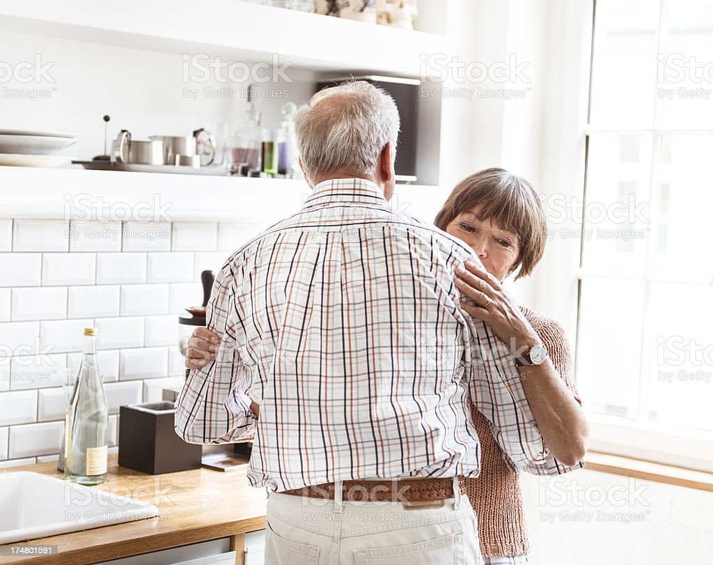 Seniors grandparents standing embraced and dancing royalty-free stock photo