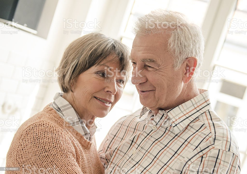 Seniors grandparents standing embraced royalty-free stock photo