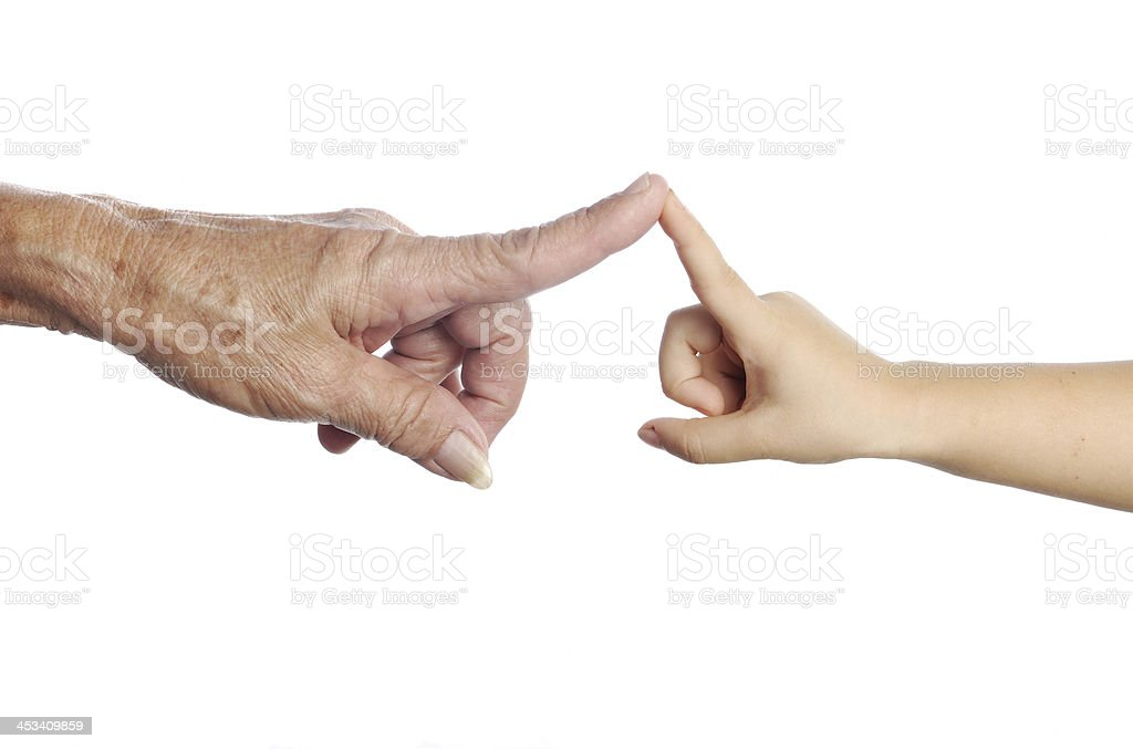 Senior's hand touching a child's one stock photo