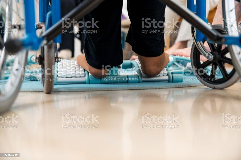 Seniors Having Foot Massage With Foot Roller stock photo