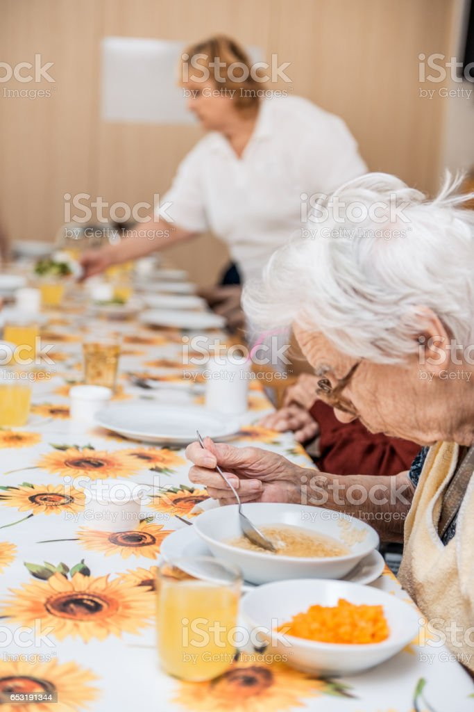 Seniors Having Lunch In The Dining Room Of The Retirement Center stock photo