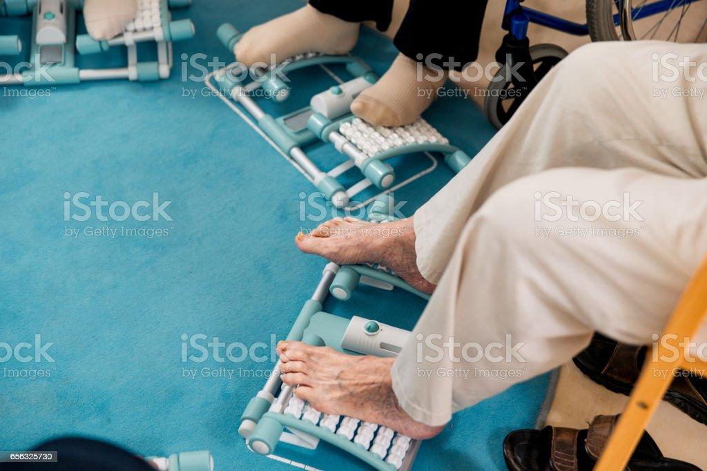 Seniors Having Reflexotherapy In The Retirement Community stock photo