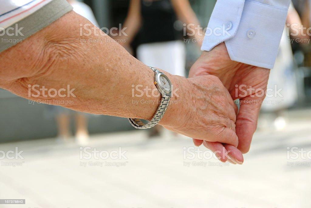 seniors holding hands royalty-free stock photo