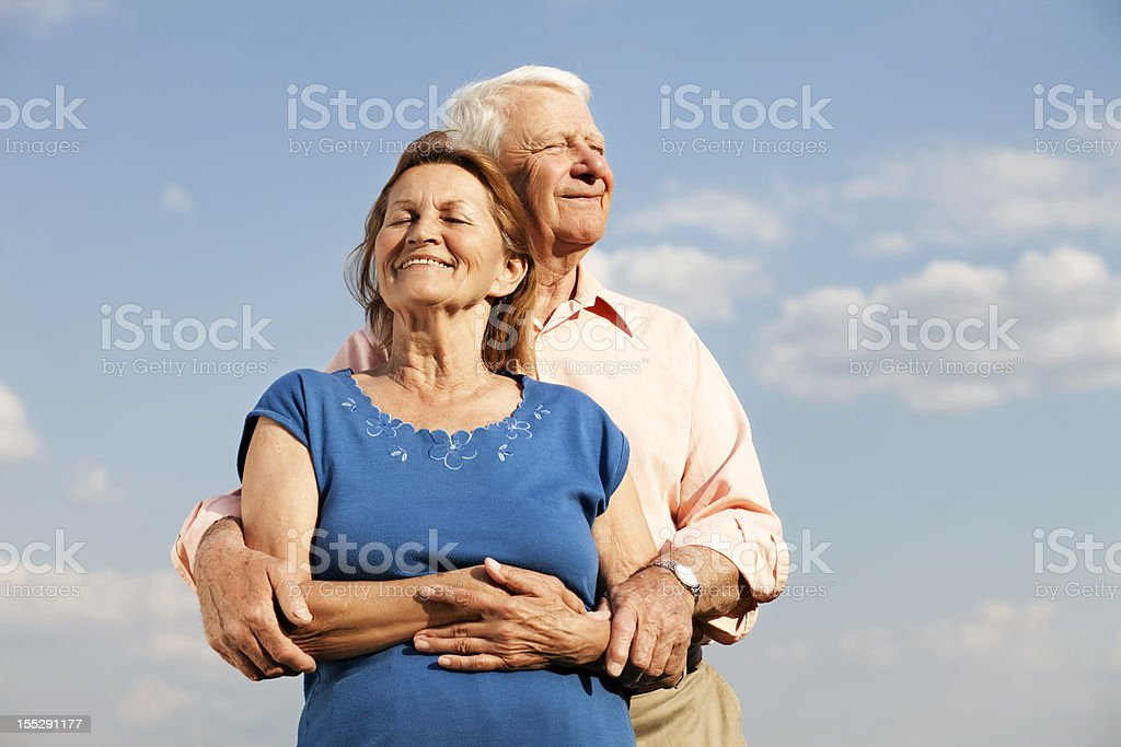 seniors in front of clouds royalty-free stock photo