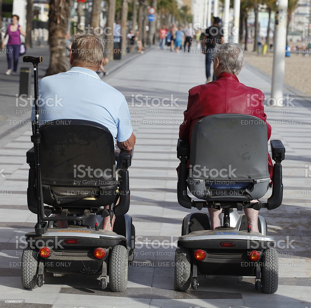 Seniors in scooter stock photo