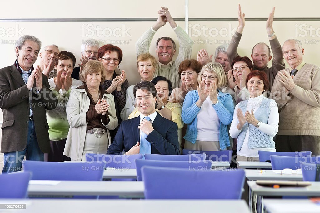Seniors in the community center applauding stock photo