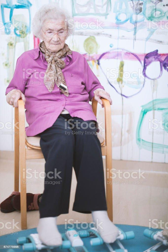 Seniors In The Nursing Home Having Reflexotherapy stock photo