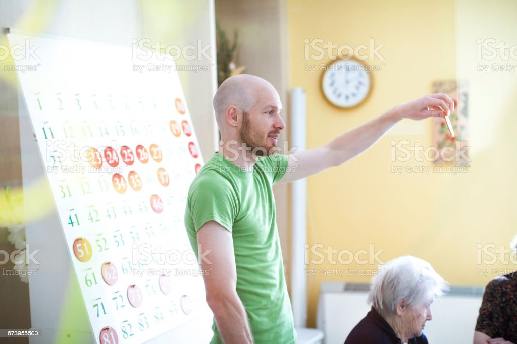 Seniors In The Nursing Home Playing Bingo For Relaxation stock photo